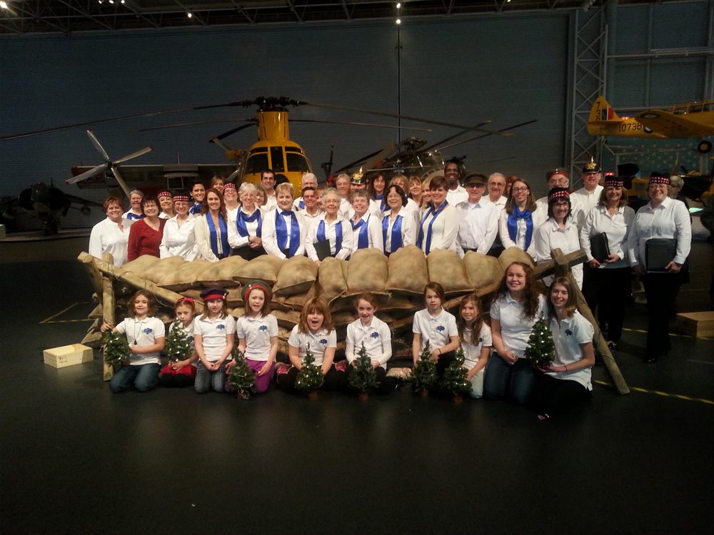Members of the JJs and GJS who participated in the December 2014 recreation of the 100th annivesary of the Christmas truce. At the Canadian Aviation and Space Museum, Ottawa, ON both sides were represented (we were the German troops) singing Christmas carols first across no man's land then together in no man's land. Choirs representing both sides are shown here